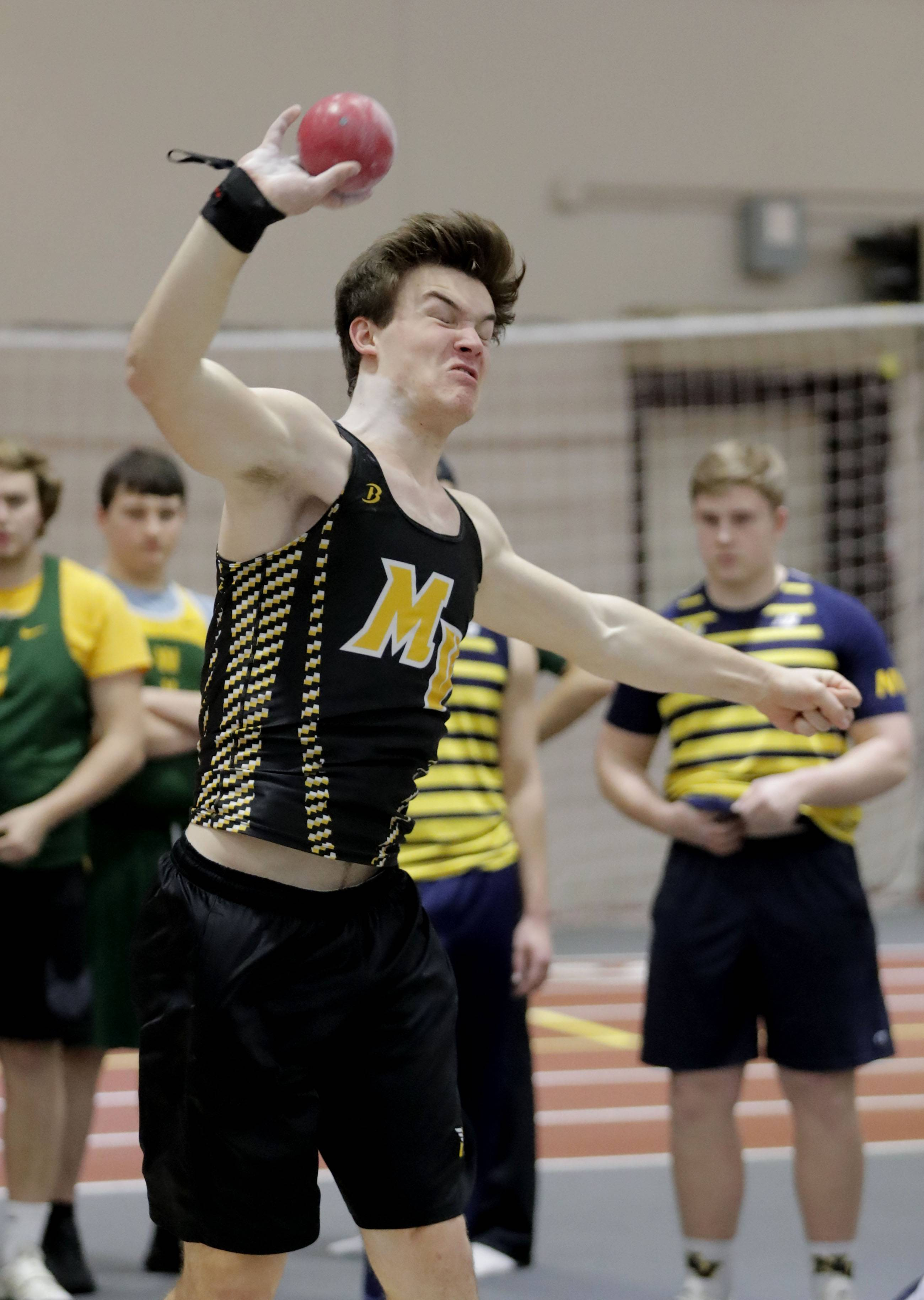 Metea Valley's Cole Pauline competes in the shot put during the DuPage Valley Conference boys track meet at North Central College in Naperville Friday.