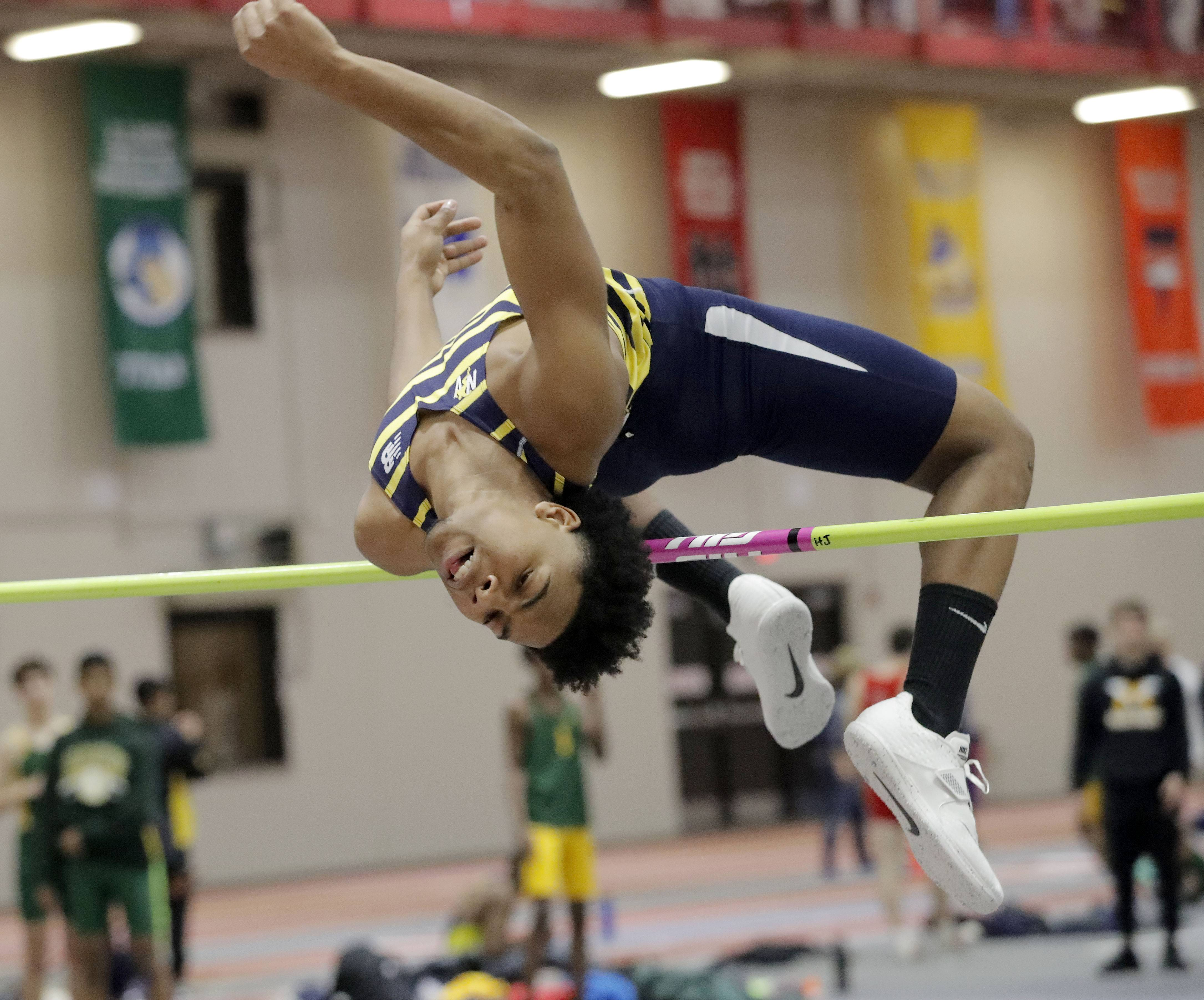 Neuqua Valley's Jared Malcolm competes in the high jump during the DuPage Valley Conference boys track meet at North Central College in Naperville Friday.