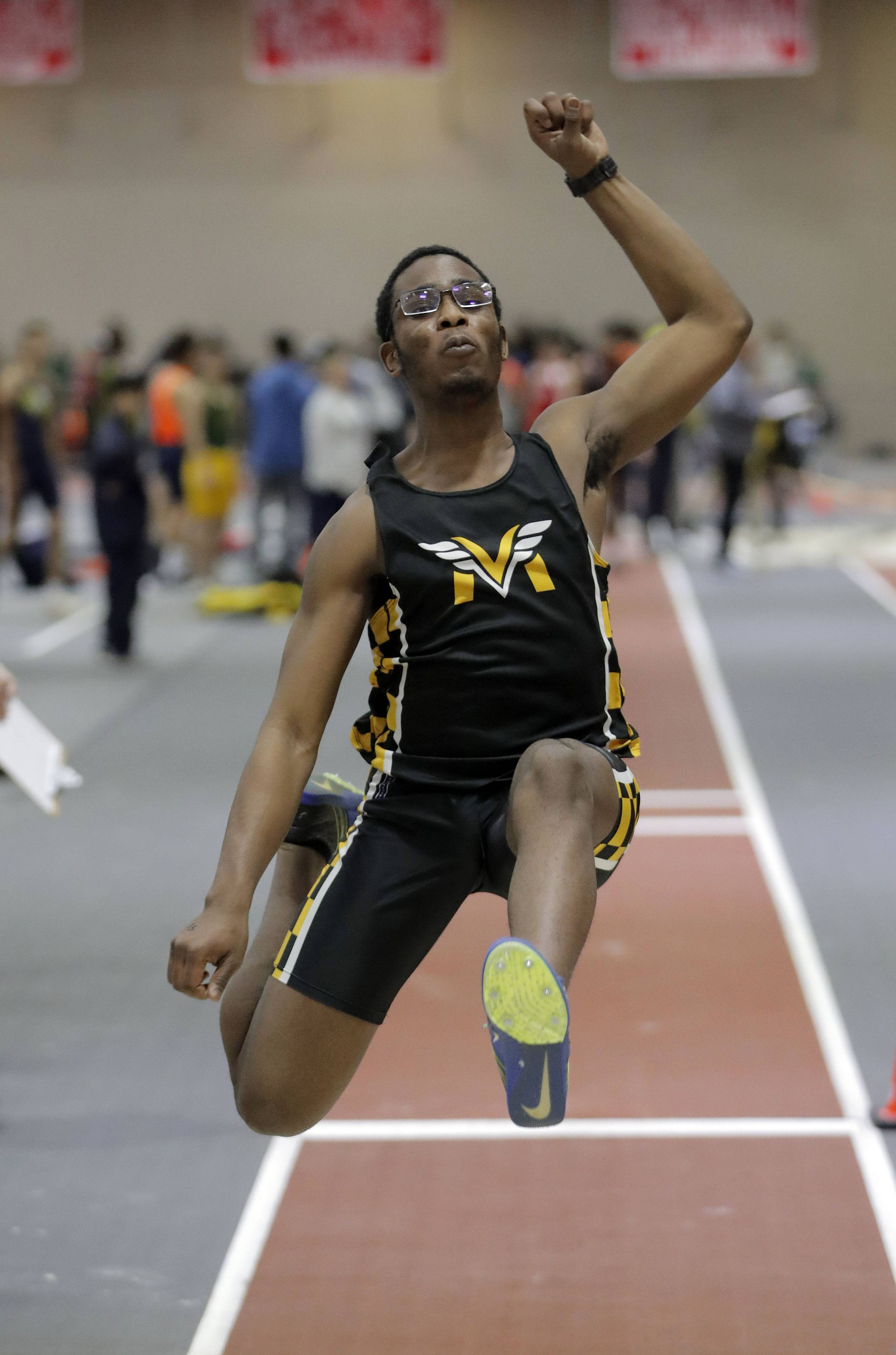 Temi Osobamiro of Metea Valley competes in the long jump during the DuPage Valley Conference boys track meet at North Central College in Naperville Friday.