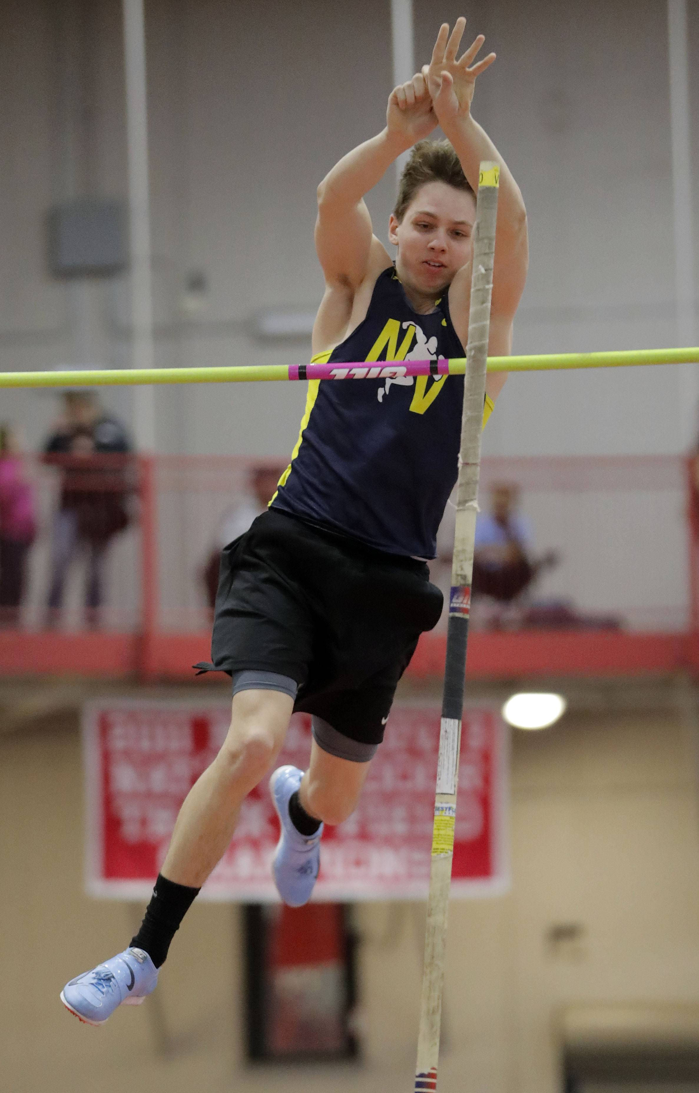 Neuqua Valley's Trevor Lambert competes in the pole vault during the DuPage Valley Conference boys track meet at North Central College in Naperville Friday.