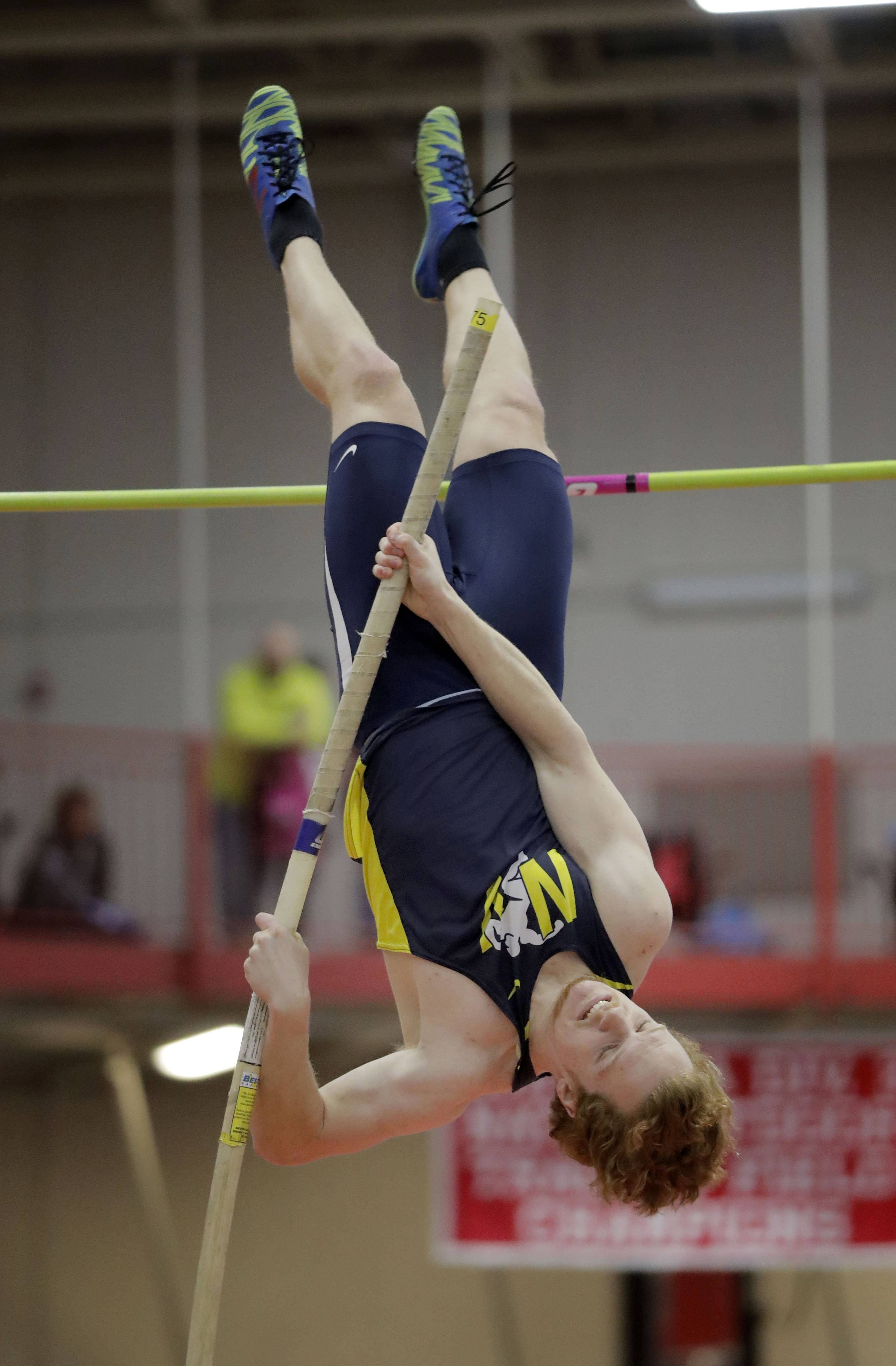 Neuqua Valley's Alexander Kiefer competes in the pole vault during the DuPage Valley Conference boys track meet at North Central College in Naperville Friday.