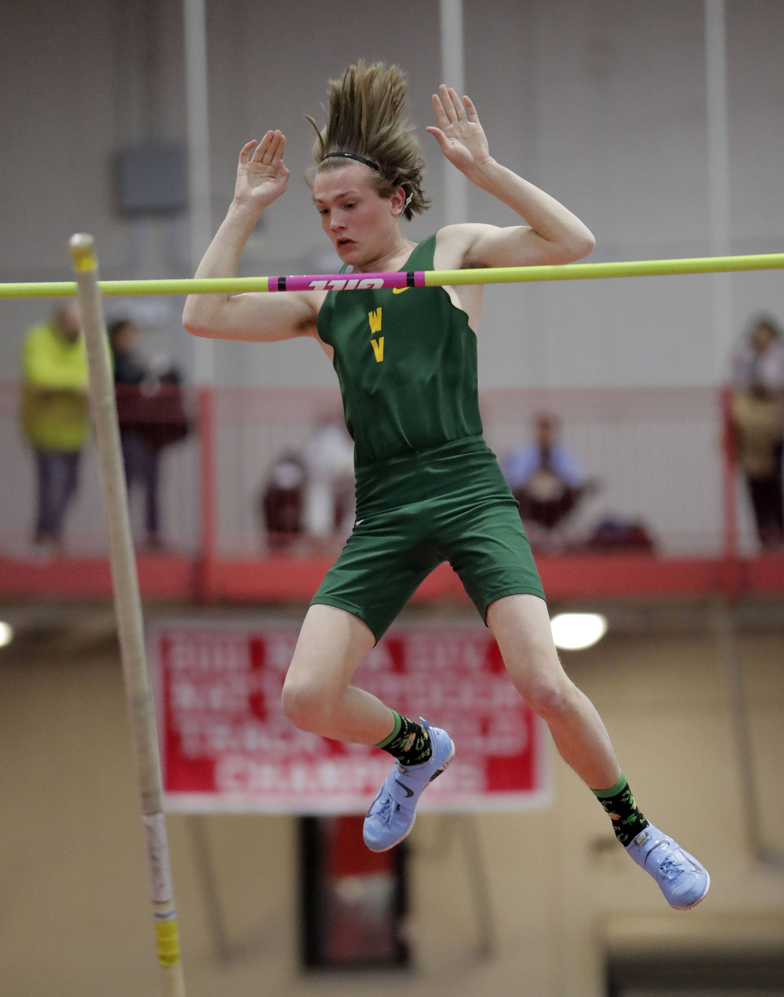 Waubonsie Valley's Aden Stapleton competes in the pole vault during the DuPage Valley Conference boys track meet at North Central College in Naperville Friday.