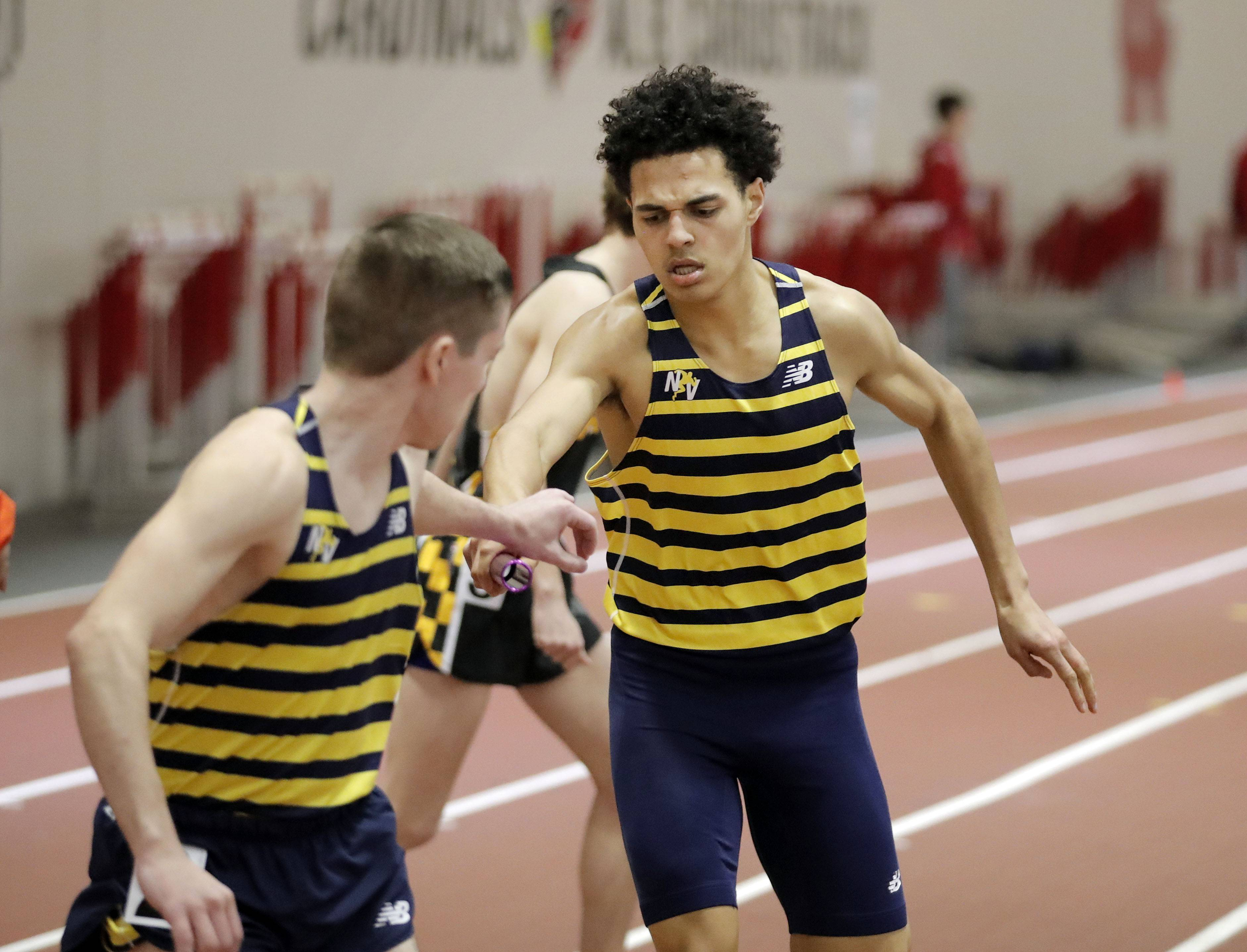 Neuqua Valley's Jordan Matthews, right, hands to Michael O'Connor in the 4x800-meter relay during the DuPage Valley Conference boys track meet at North Central College in Naperville Friday.
