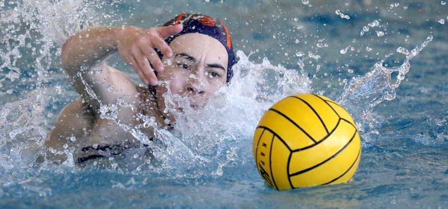 Buffalo Grove's Andy Gontko moves the ball against Warren during varsity boys water polo at Buffalo Grove Friday night.