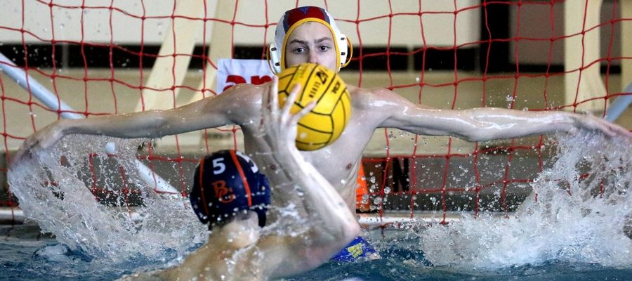 Warren's goalie Riley Nebel rises to block a shot by Buffalo Grove's Aidan Nix during varsity boys water polo at Buffalo Grove Friday night. Nix scored on the play.
