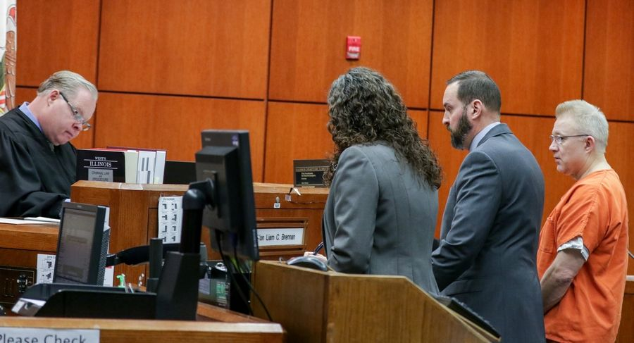 Judge Liam Brennan hears a plea from Joseph Kucharski, right, with his lawyer Jay Fuller, center, and prosecutor Kristin Johnston, second from right, at the DuPage County courthouse in Wheaton on Friday.