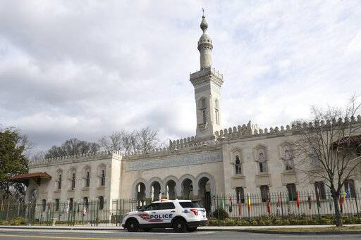 A police vehicle is parked outside the Islamic Center of Washington, Friday, March 15, 2019 in Washington.