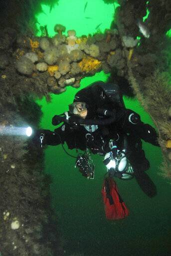 This 2017 photo provided by Tom McCarthy shows a diver exploring the wreck of the SS Oregon off the coast of Long Island in New York. An ale introduced at a New York craft beer festival on March 9, 2019, came with an intriguing backstory, brewed from yeast in beer that went down on a doomed steamship and languished on the ocean floor for 131 years. Long Island brewer Jamie Adams created his new Deep Ascent ale using yeast from bottles he and fellow divers salvaged from the SS Oregon that sank off Fire Island in 1886. (Tom McCarthy/East Coast Wreck Diving via AP)