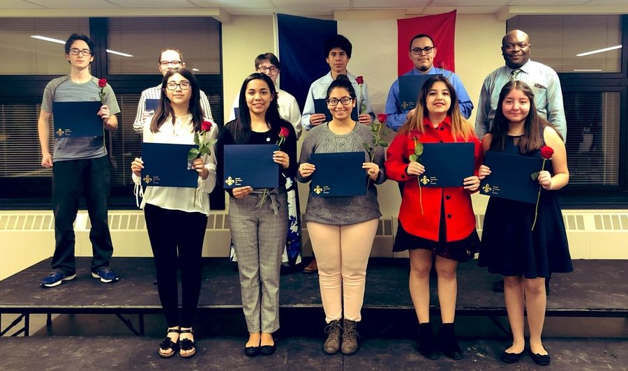 Ten East Leyden students were inducted into the French Honor Society in late February.  They are pictured with club sponsor Hugues Zoffoun.Courtesy of District 212