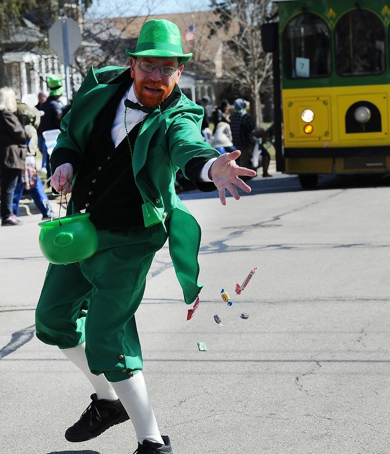 Palatine's Jason Foltyn lets the candy fly at the 2017 St. Patrick's Day parade in Palatine.