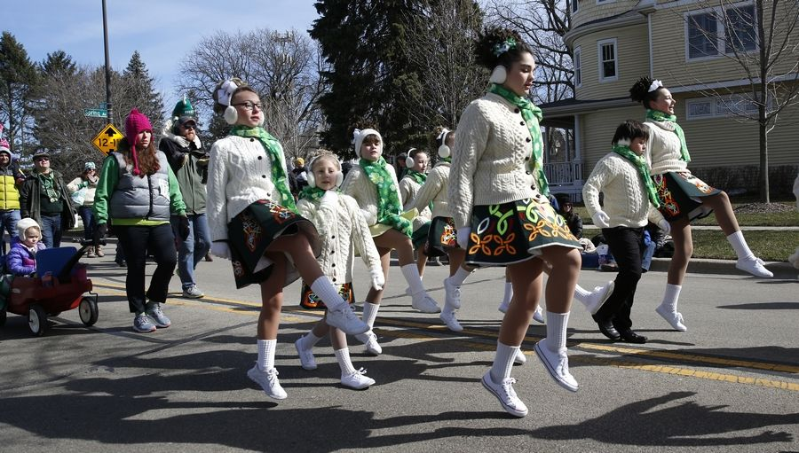 The McNulty Irish dancers march down Mill Street during the 2017 West Suburban Irish St. Patrick's Day parade in Naperville.