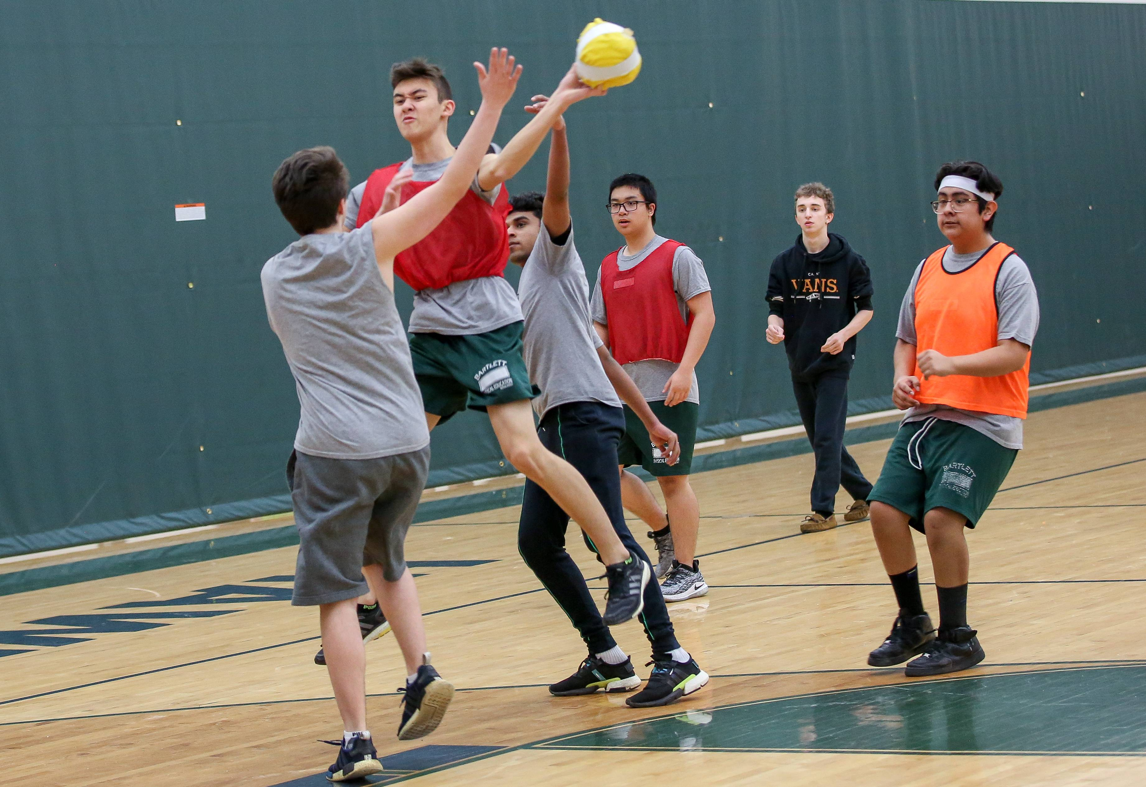 Juniors and seniors play handball in their team sports class at Bartlett High School on Thursday. Elgin Area School District U-46 this fall will be testing an independent, online physical education curriculum, allowing high school students to be in charge of their own wellness.