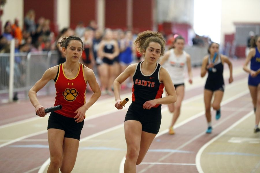 Batavia's Erin O'Brien and St. Charles East's Grace Jackson take off at the start of the 3,200 relay Saturday during the DuKane Conference girls track and field meet in Batavia.
