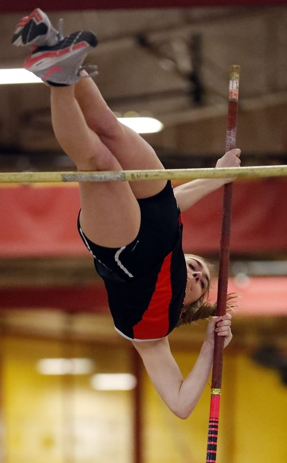 St. Charles East's Blakely Kresl in the pole vault Saturday during the DuKane Conference girls track meet in Batavia.