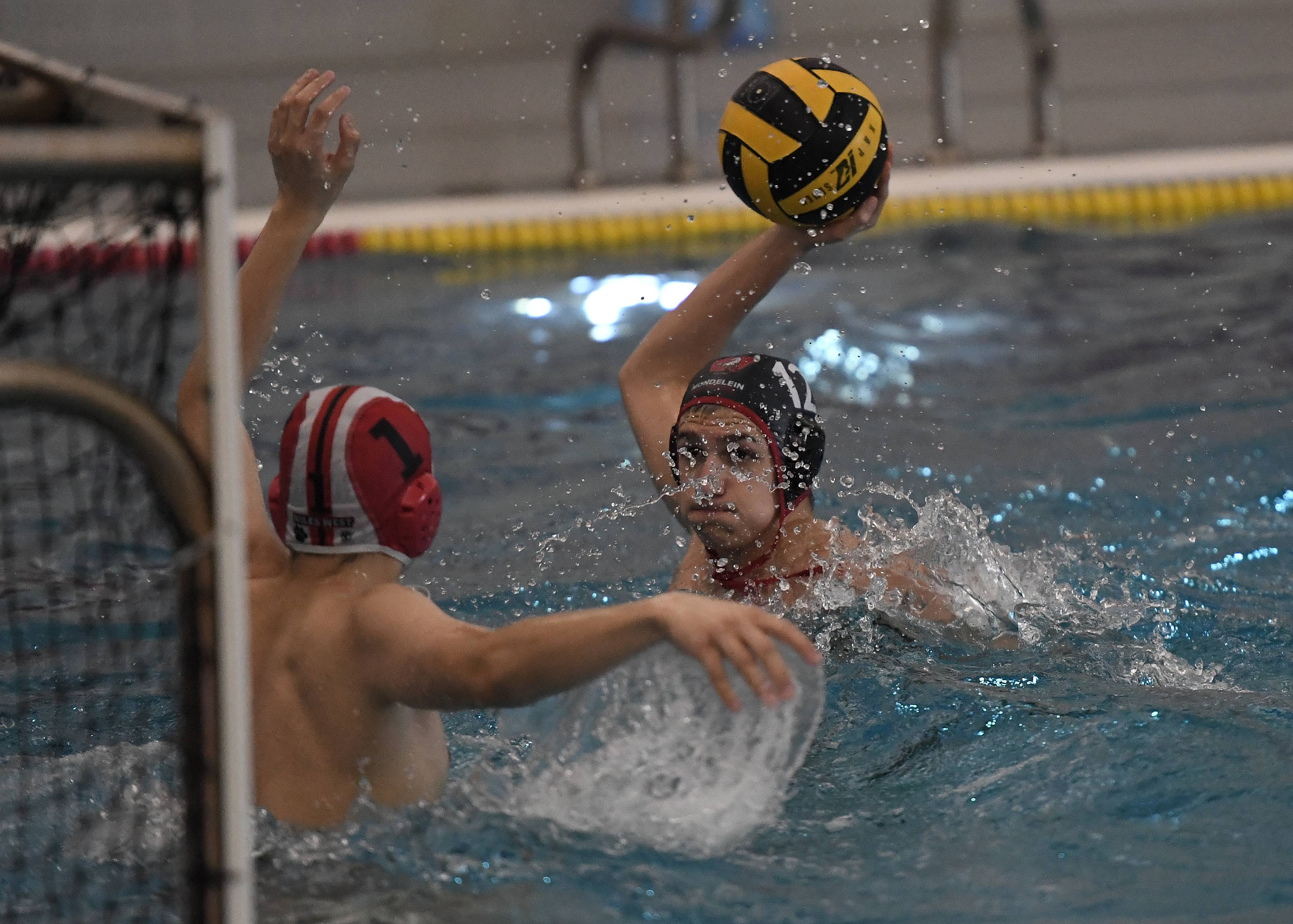 Mundelein's Jake Garcia is seconds away from scoring against Niles West's goalie in the boys water polo varsity invite at Mundelein High School on Saturday.
