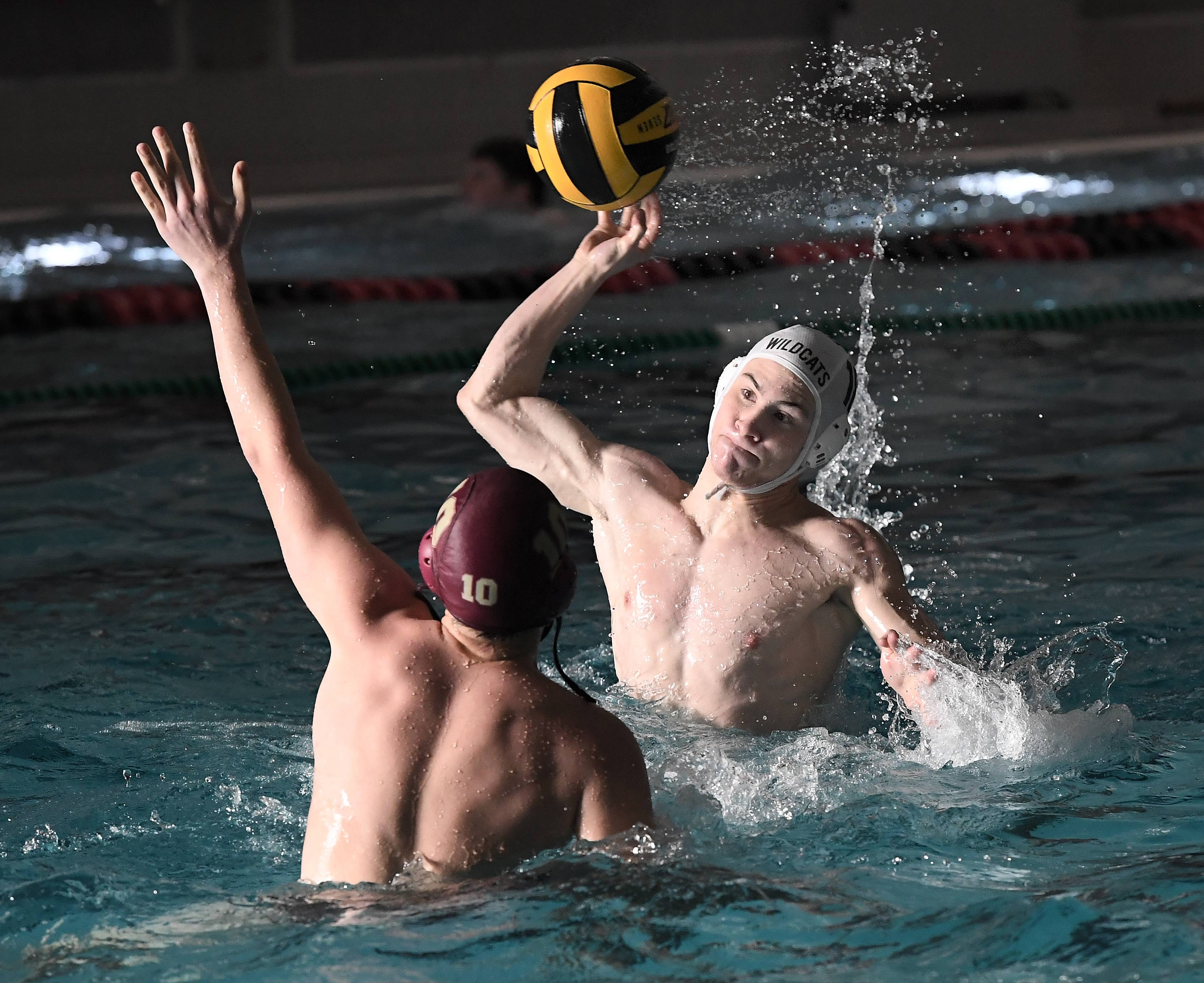 Libertyville's Jonah Armenta fires to the net as Lockport's Trent Lambert defends in the boys water polo varsity invite at Mundelein High School on Saturday.