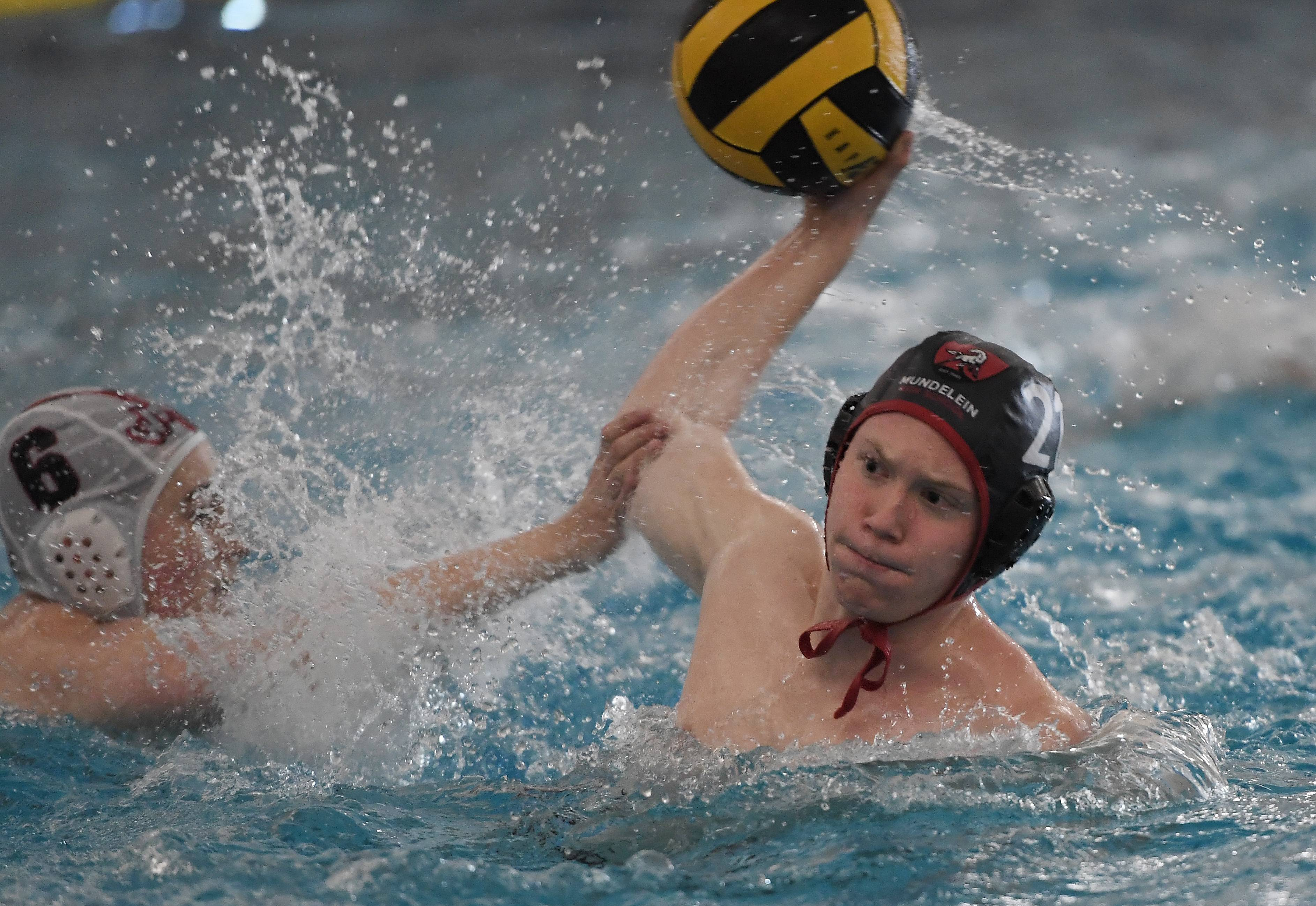 Mundelein's Hunter Magee is unstoppable against Nile West's defense in the boys water polo varsity invite at Mundelein High School on Saturday.