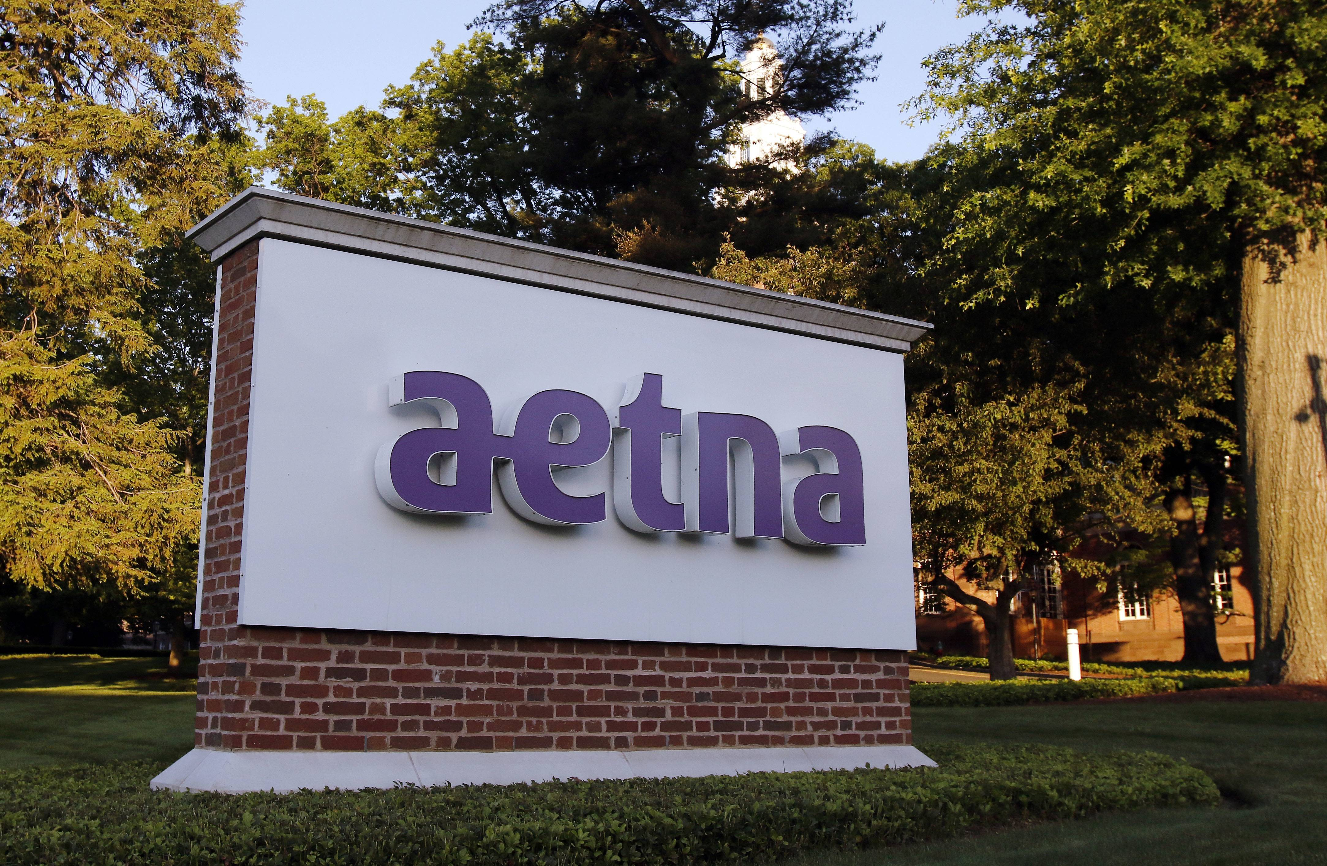 Insurer Aetna is one of a growing list of companies helping employees pay down student loans.