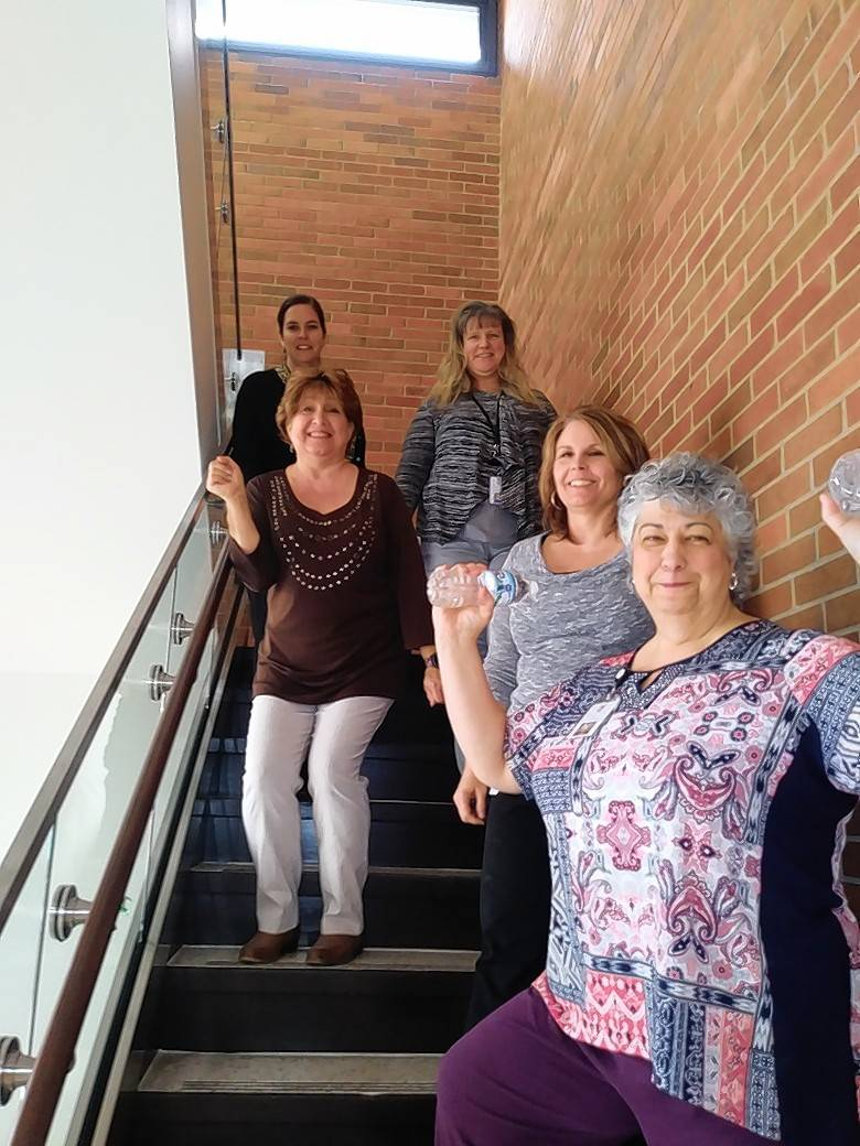 "Village of Hanover Park Finance Department's ""Hanover Park Net Loss"" is taking the stairs! Counterclockwise from bottom right is Tomasa Reis, Sheryl Donovan, Andrea Granias, Suzanne Thorson, and Ruth Roenna."