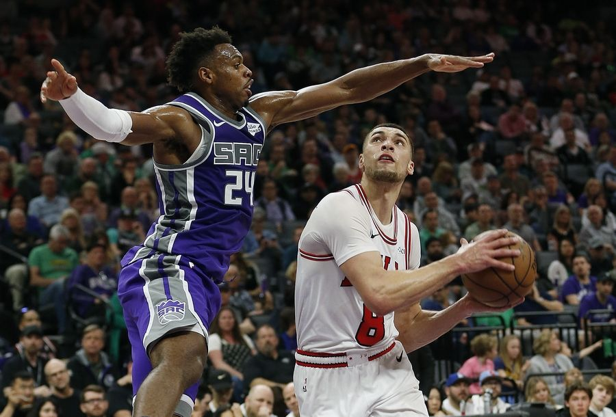 Chicago Bulls guard Zach LaVine, right drives to the basket against Sacramento Kings guard Buddy Hield during the second half of an NBA basketball game Sunday, March 17, 2019, in Sacramento, Calif. The Kings won 129-102.