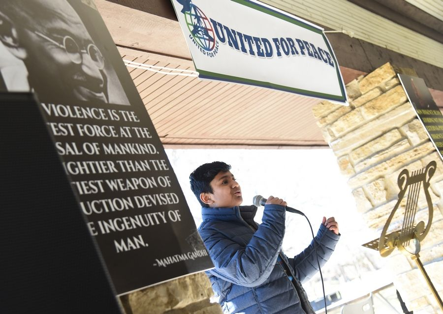 "Pratik Chakraborty sings John Lennon's ""Imagine"" during a United for Peace Rally Sunday at the Riverwalk Grand Pavilion in Naperville. The purpose of the rally was to promote unity and peace among all communities."
