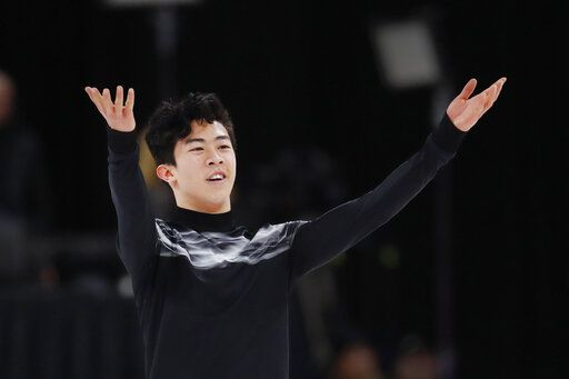 FILE - In this Jan. 27, 2019, file photo, Nathan Chen acknowledges the audience after performing the men's free skate at the U.S. Figure Skating Championships in Detroit. Defending champion Nathan Chen heads to the world figure skating championships in Japan balancing the rigors of competition with the scholastic requirements of being an undergraduate at Yale.