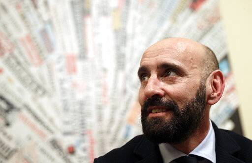 "FILE - In this file photo dated Wednesday, March 28, 2018, Roma sports director Ramon Rodriguez Verdejo, known as Monchi, talks to journalist during a press conference in Rome. Sevilla said Sunday March 17, 2019,  former sports director Roman ""Monchi� Rodriguez, the man credited with building several title-winning squads, is returning to his old job."