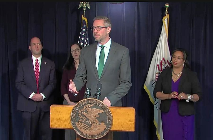Illinois State Treasurer Michael Frerichs discusses legislation he is backing in the General Assembly that would eliminate state-level regulations that prohibit banks and credit unions from serving legitimate cannabis businesses. With him at the news conference Monday in Chicago are, from left, DuPage County State's Attorney Robert Berlin, Democratic state Rep. Kelly Cassidy of Chicago, and Democratic state Sen. Toi Hutchinson of Olympia Fields.