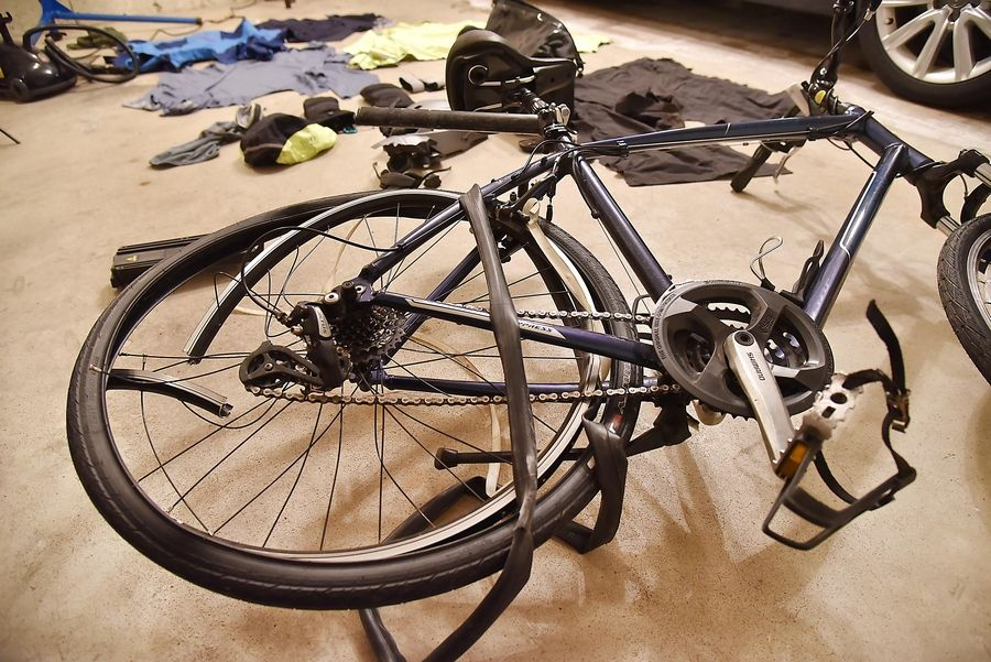 "Carl Schoedel's bicycle was battered after he was hit from behind by a passing car Tuesday. ""Knowing myself, I'll be back on the bike,"" he says."