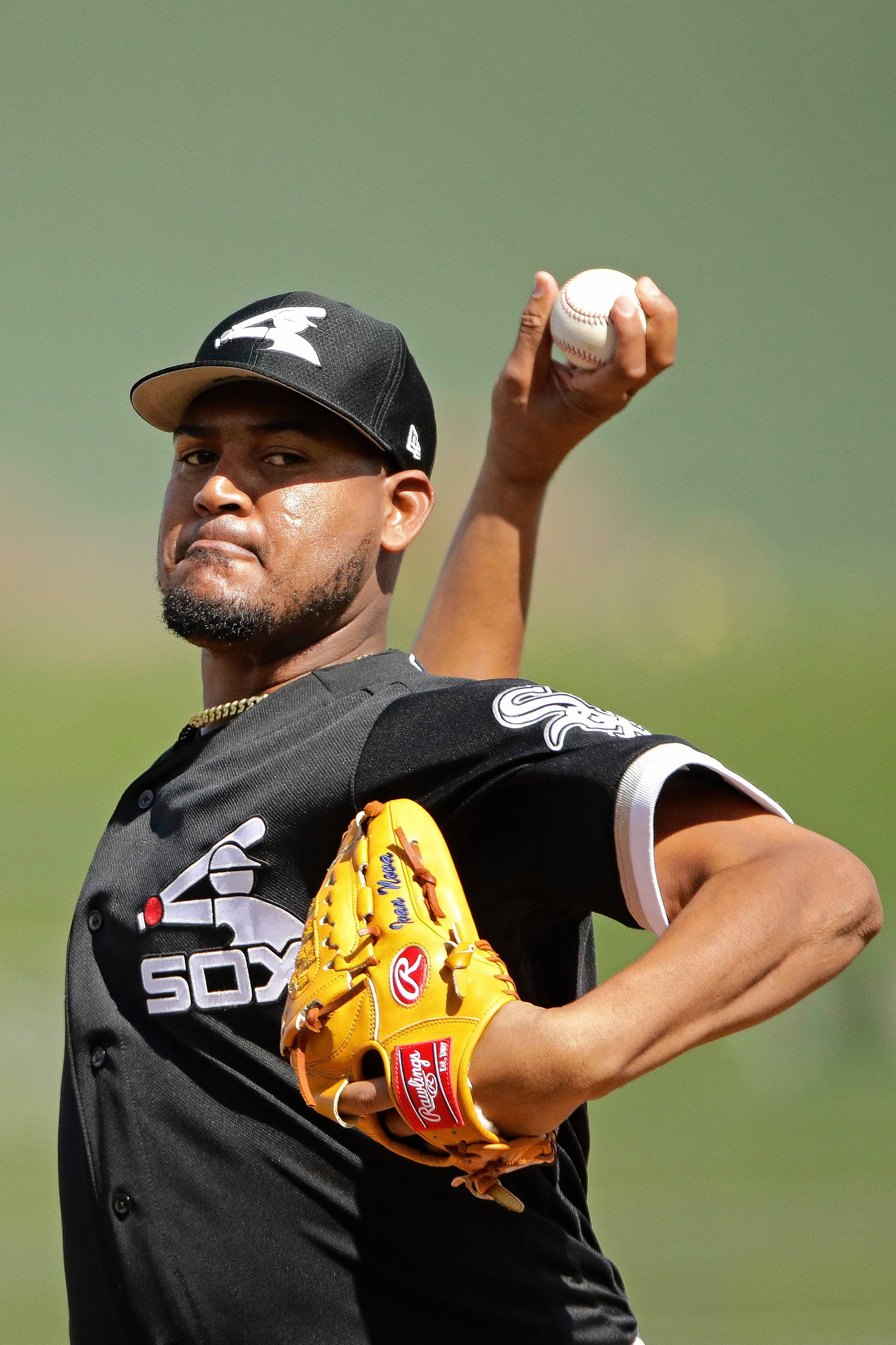 Chicago White Sox starting pitcher Ivan Nova throws during the first inning of the team's spring training baseball game against the Texas Rangers on Friday, March 1, 2019, in Surprise, Ariz.