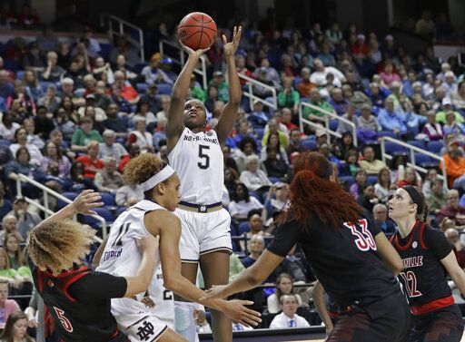 Notre Dame's Jackie Young (5) shoots against Louisville during the second half of an NCAA college basketball game in the championship of the Atlantic Coast Conference women's tournament in Greensboro, N.C., Sunday, March 10, 2019. Young was named the tournament's MVP.