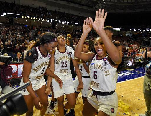 Mississippi State's Anriel Howard (5) along with her teammates celebrate after winning an NCAA college basketball championship game 101-70 against Arkansas in the Southeastern Conference women's tournament, Sunday, March 10, 2019, in Greenville, S.C.