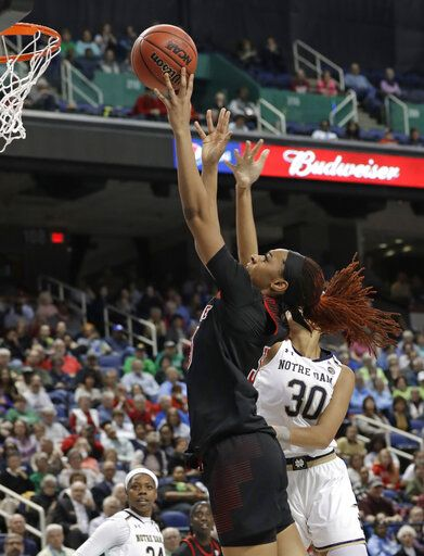 Louisville's Bionca Dunham, left, shoots against Notre Dame's Mikayla Vaughn (30) during the first half of an NCAA college basketball game in the championship of the Atlantic Coast Conference women's tournament in Greensboro, N.C., Sunday, March 10, 2019.