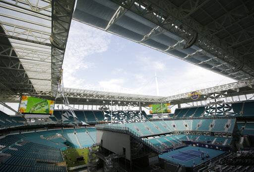 The Miami Open tennis tournament's center court is viewed at Hard Rock Stadium, Monday, March 18, 2019, in Miami Gardens, Fla. The Miami Open has moved north from its home since 1987, the picturesque island of Key Biscayne, and will begin Tuesday at the home of the Miami Dolphins and Miami Hurricanes.