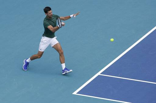 Novak Djokovic practices on center court for the Miami Open tennis tournament at Hard Rock Stadium, Monday, March 18, 2019, in Miami Gardens, Fla. The Miami Open has moved north from its home since 1987, the picturesque island of Key Biscayne, and will begin Tuesday at the home of the Miami Dolphins and the Miami Hurricanes.