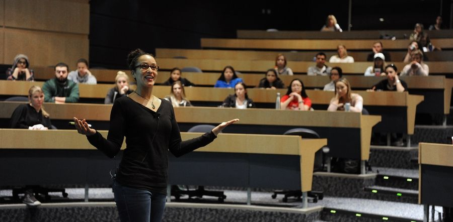 Nicole Snell, senior national speaker for the Students Fight Back program, addresses the faculty and students of Harper College in Palatine on Tuesday. The program, which stems from the organization of Girls Fight Back, aims to help men and women stand together against the violence.