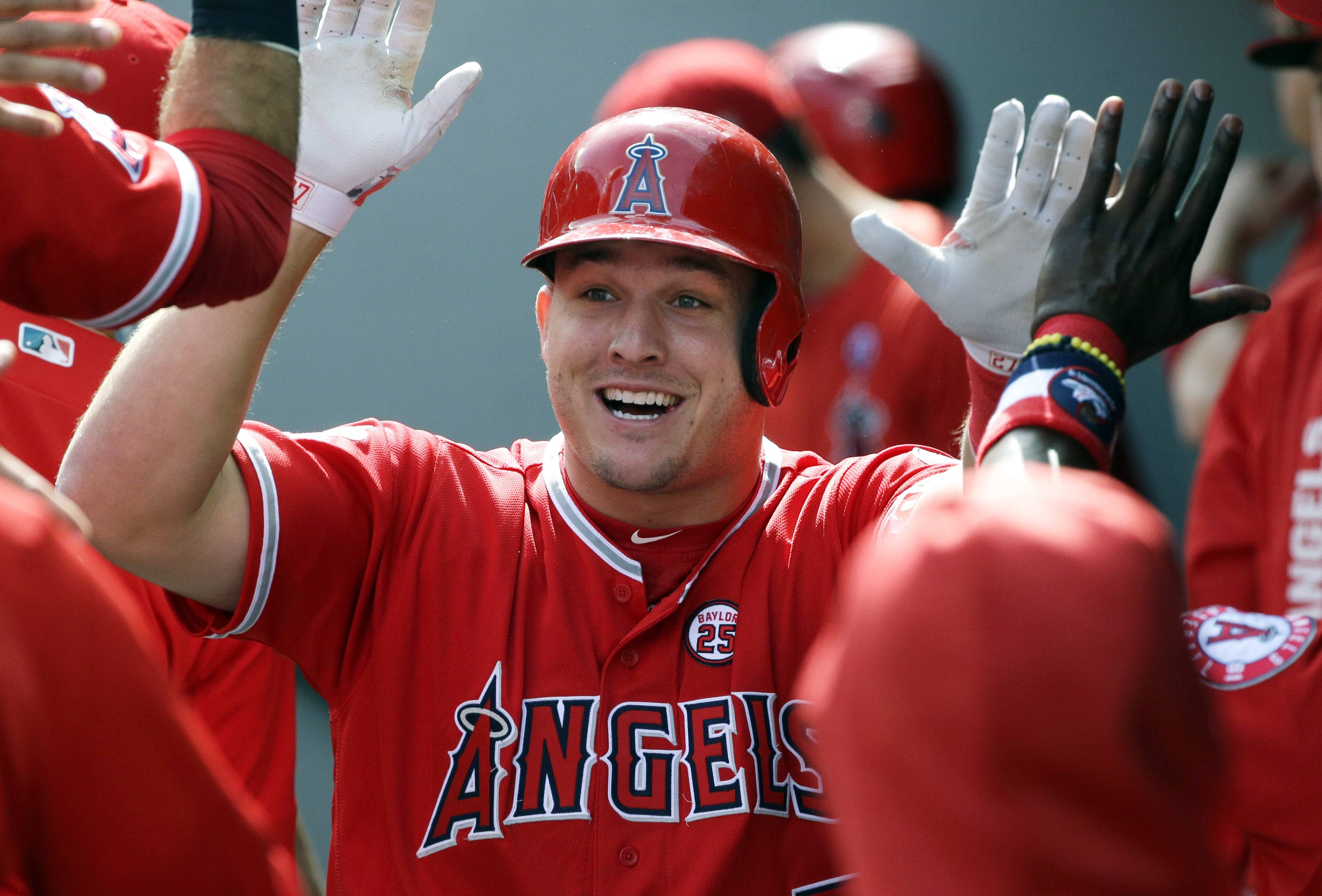 A person familiar with the negotiations tells The Associated Press Tuesday that Mike Trout and the Anaheim Angels are close to finalizing a record $432 million, 12-year contract that would shatter the record for the largest deal in North American sports history.