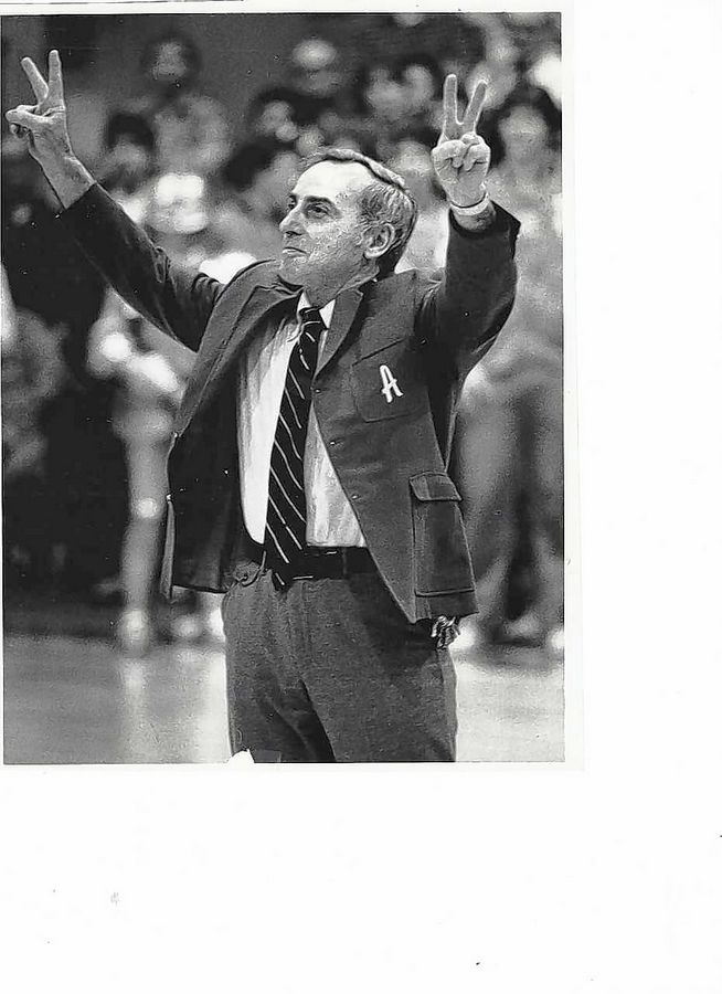 Russell Attis, a longtime athletic director and coach at Arlington High School, passed away last weekend. Here he acknowledges the crowd after the final Arlington basketball game in 1984 in Grace Gym.