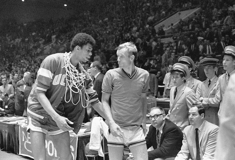 My first NCAA tournament prediction was that Rick Mount, right, and his 1969 Purdue team would beat UCLA and Lew Alcindor, left. UCLA won, and Alcindor became Kareem Abdul-Jaabar and the NBA's leading scorer. Mount opened a hunting and fishing shop in Lebanon, Indiana.