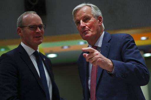 European Union Brexit negotiator Michel Barnier, right, talks to Irish Foreign Minister Simon Coveney during a meeting of EU ministers for European Affairs at the EU Council building in Brussels, Tuesday, March 19, 2019. The British government was preparing Tuesday to ask the European Union for a delay of at least several months to Brexit after the speaker of the House of Commons ruled that Prime Minister Theresa May cannot keep asking lawmakers to vote on the same divorce deal that they have already rejected twice.