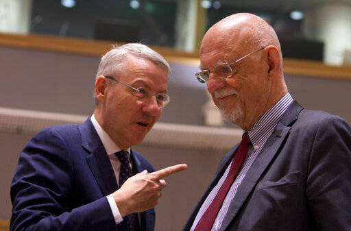 Romania's Minister for European Affairs George Ciamba, left, speaks with Sweden's European Affairs Minister Hans Dahlgren during a meeting of EU ministers for European Affairs at the EU Council building in Brussels, Tuesday, March 19, 2019. Germany's European affairs minister Michael Roth says Brexit is not a game and that the EU is worn out by two years of tortuous and interminable negotiations over Britain's departure from the bloc.