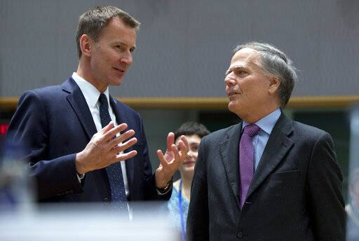 British Foreign Secretary Jeremy Hunt, left, speaks with Italian Foreign Minister Enzo Moavero Milanesi during a meeting of EU foreign ministers at the EU Council building in Brussels, Monday, March 18, 2019. EU foreign ministers hold talks with their Chinese counterpart as the bloc seeks to establish a new strategic balance with the Asian economic giant.