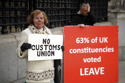 Pro-Brexit supporters protest outside the Houses of Parliament in London, Monday, March 18, 2019. British Prime Minister Theresa May was making a last-minute push Monday to win support for her European Union divorce deal, warning opponents that failure to approve it would mean a long - and possibly indefinite - delay to Brexit. Parliament has rejected the agreement twice, but May aims to try a third time this week if she can persuade enough lawmakers to change their minds.