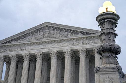 In this Jan. 7, 2019 photo, The Supreme Court is seen in Washington. Supreme Court justices are again considering how to keep prosecutors from removing African-Americans from criminal juries for racially biased reasons, this time in a case involving a Mississippi death row inmate who has been tried six times for murder.