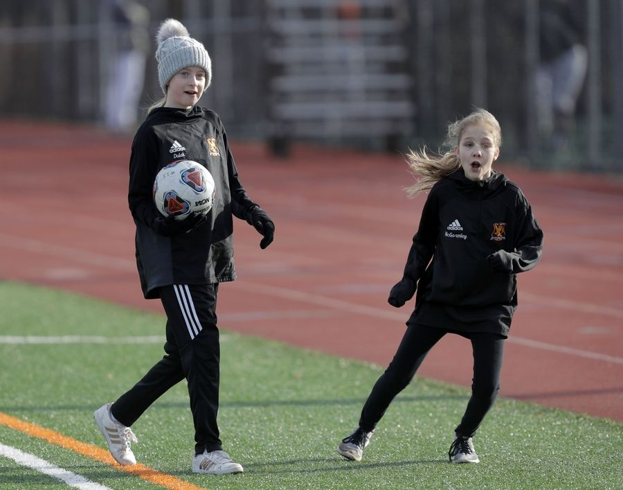 Sydney Dulak, left, and Tess McGormley, both 12 and from Libertyville act as ball girls during girls soccer action Tuesday at Libertyville High School.