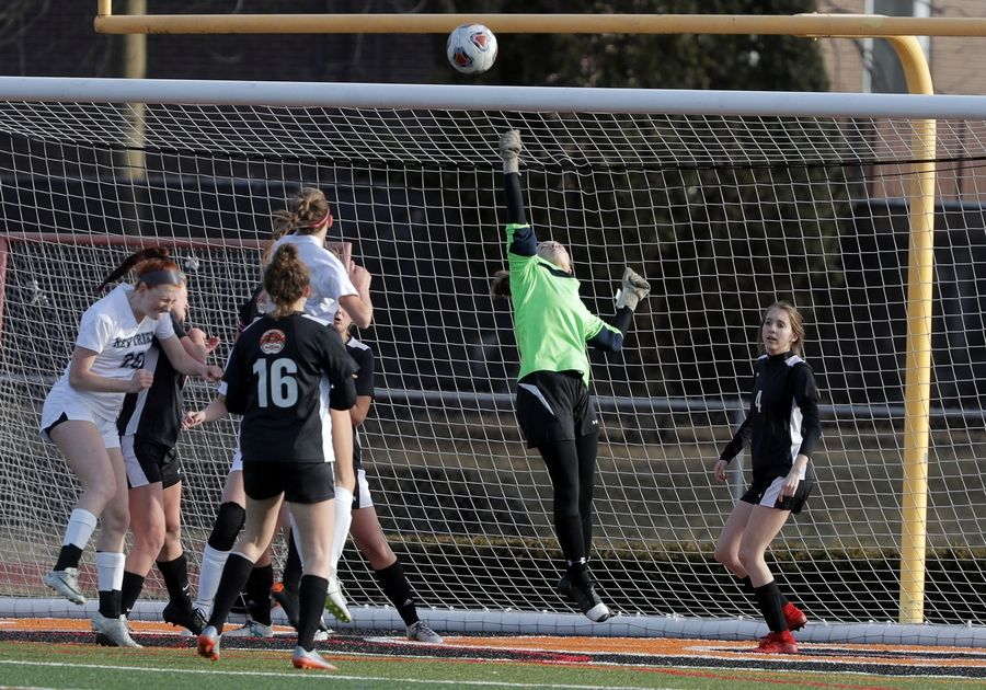 Libertyville goalie Abby Noonan goes up for a save during their game against New Trier Tuesday at Libertyville High School.
