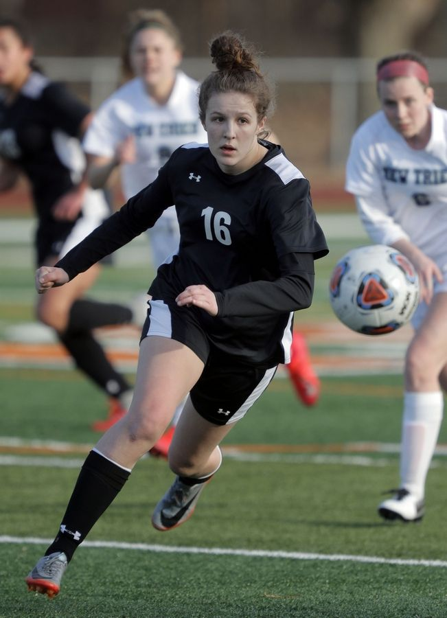 Libertyville's Lauren Huber drives up field during their game against New Trier Tuesday at Libertyville High School.