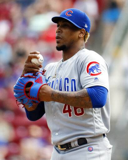 FILE- In this June 24, 2018, file photo, Chicago Cubs relief pitcher Pedro Strop reacts in the seventh inning of a baseball game against the Cincinnati Reds in Cincinnati. Strop has a strained right hamstring, eliminating the likely candidate to close at the start of the season as Brandon Morrow recovers from elbow surgery. (AP Photo/John Minchillo, File)