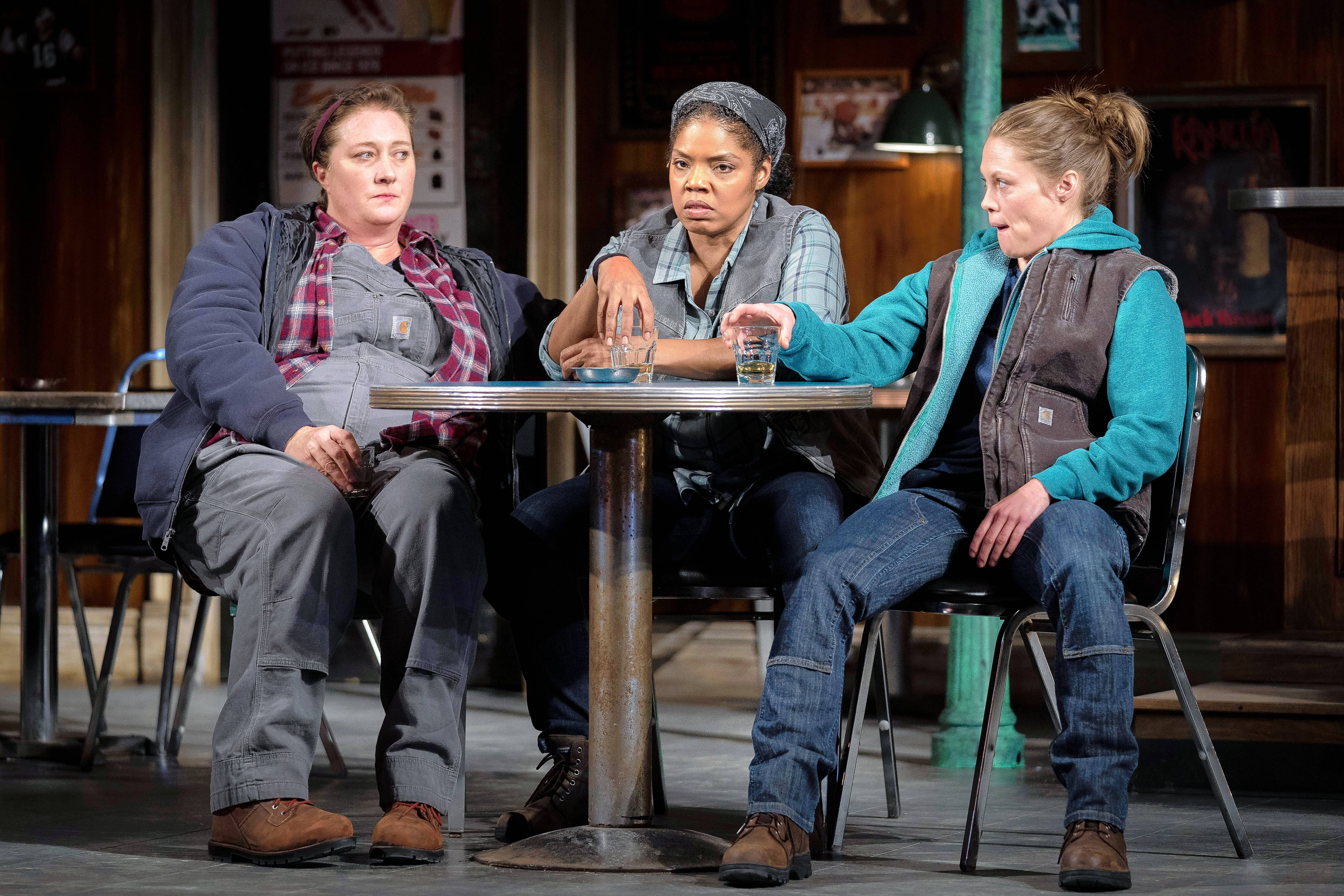 "Kirsten Fitzgerald, left, Tyla Abercrumbie and Chaon Cross play co-workers whose friendship is tested by the threat of layoffs in Goodman Theatre's revival of Lynn Nottage's Pulitzer Prize-winning ""Sweat."""