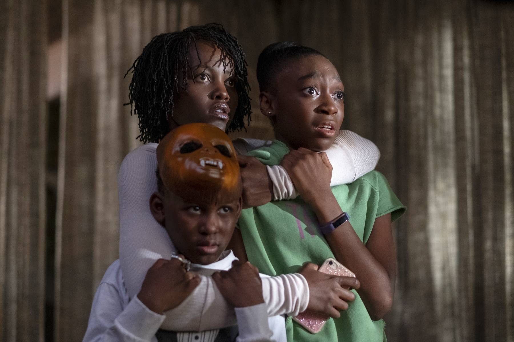 "Adelaide (Lupita Nyong'o) shields her son (Evan Alex) and daughter (Shahadi Wright Joseph) from homicidal dopplegangers in ""Us,"" written, produced and directed by Jordan Peele."